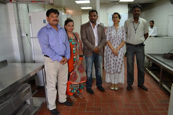 Saba, second from right, with her School Meals team