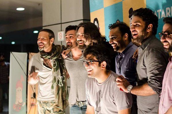 The ecstatic Patari team histing their music heroes in their studio